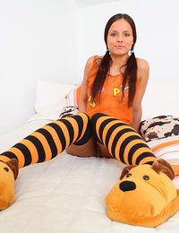 This sexy teen babe in her black and orange stockings loves to show off her perky titties and just the thought of someone watching her is enough to get her tight teen pussy dripping wet!